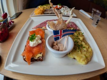 plate of food with a little Icelandic flag in it at Cafe Loki in Reykjavik