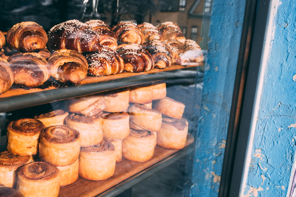 Cinnamon rolls and croissants in the window of the bakery Braud and Co.
