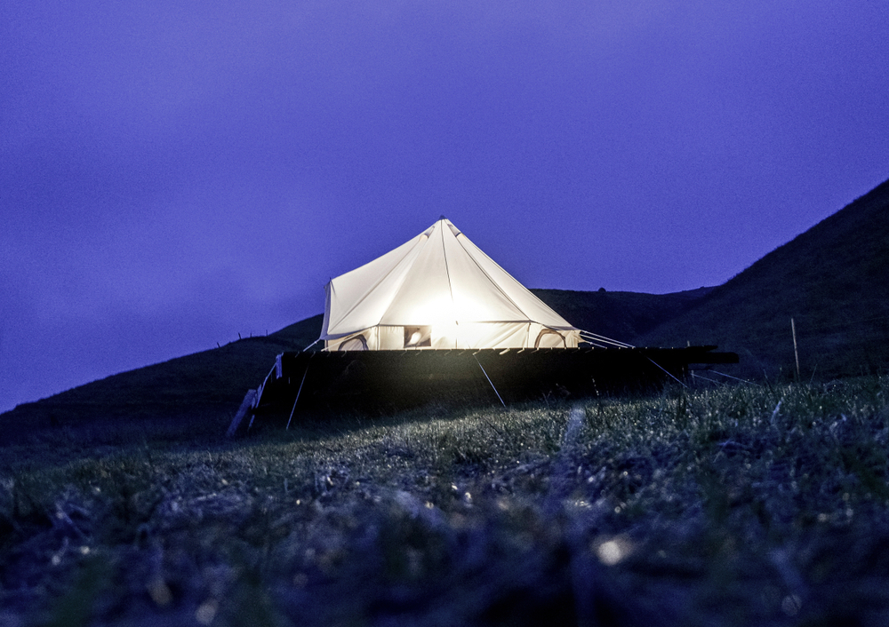 glamping tent in iceland at night lit up