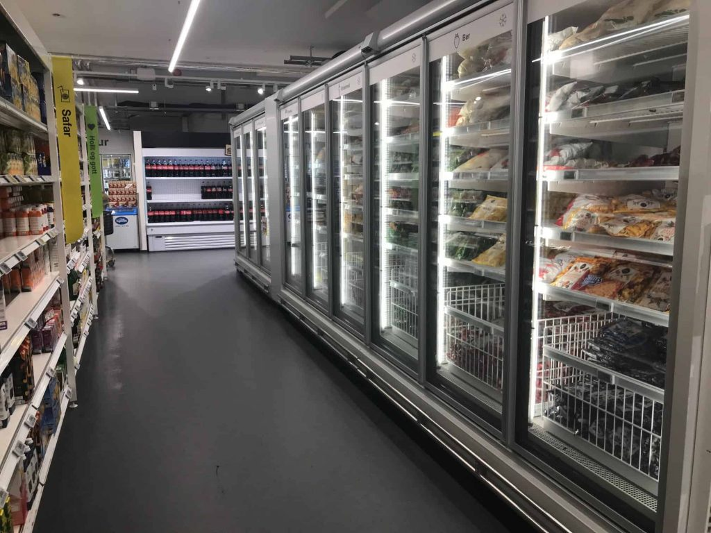 the frozen food isle of a grocery store in iceland