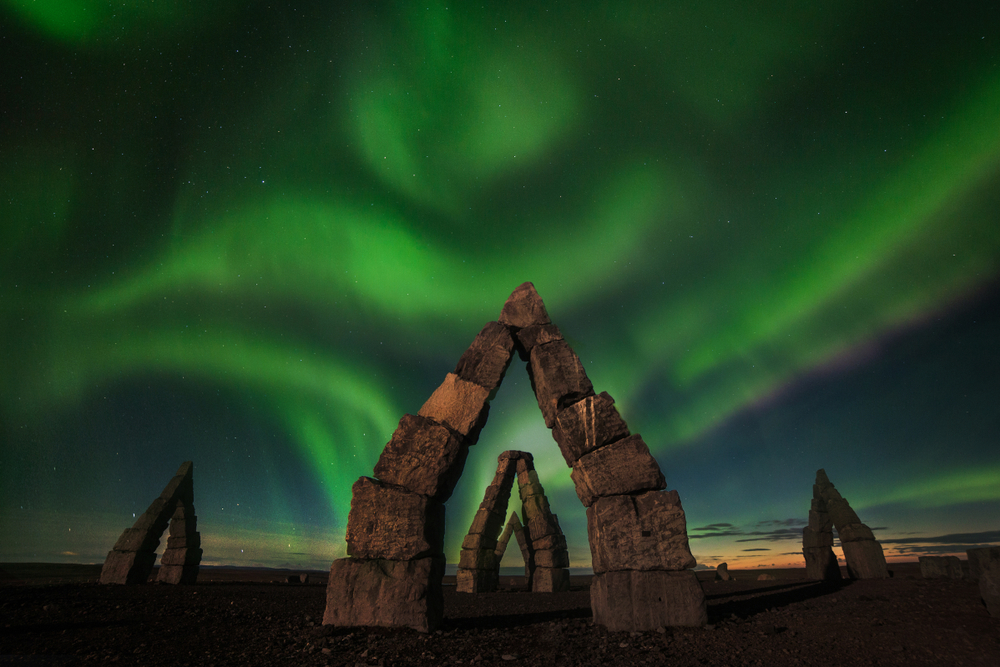 the Northern Lights over stone man made  structures in iceland