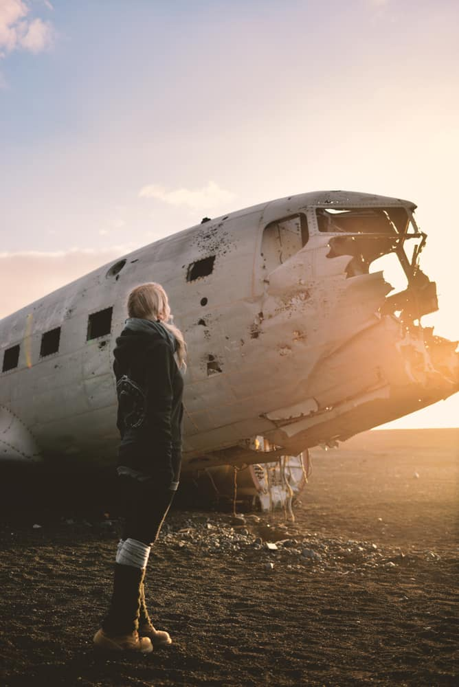 woman standing next to the Iceland plane crash