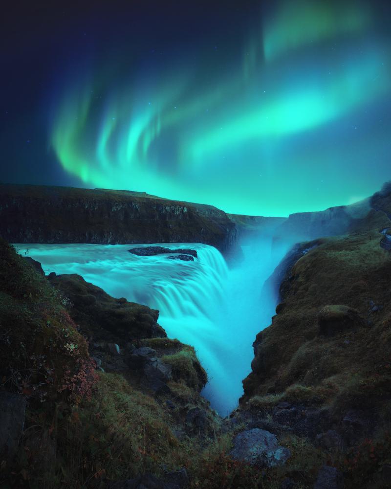 Northern Lights over Gullfoss waterfall along the Golden Circle