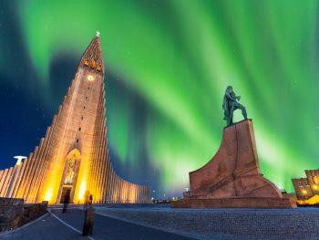 the Northern Lights in Reykjavik over Hallgrimskirkja church downtown