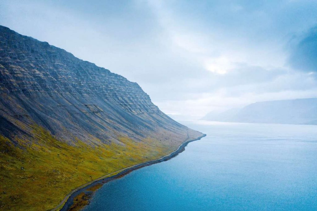 drone image of the westfjords in iceland on a moody day