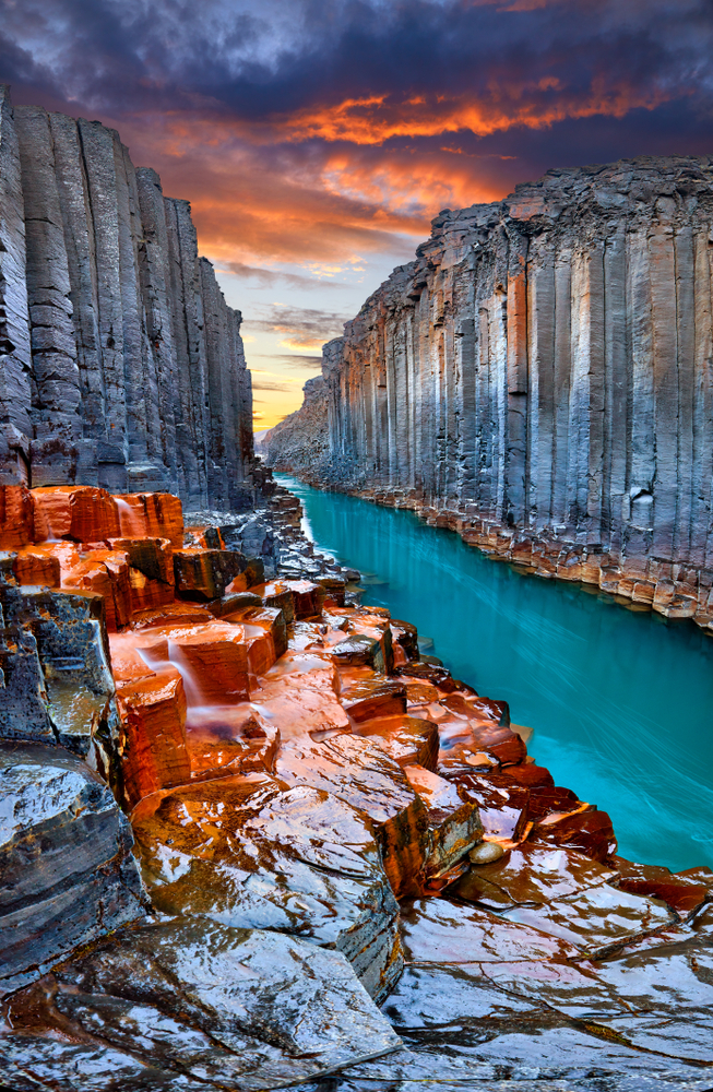 Iceland Canyon Studlagil Basalt Canyon with colorful stone and blue river   basalt canyon in Iceland with glacier river