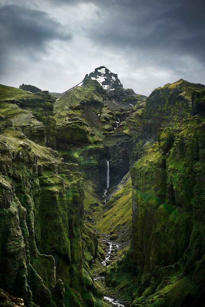 Iceland Canyons Mulagljufur Canyon with waterfall and mountain   canyon in Iceland with a waterfall coming out of a mountain