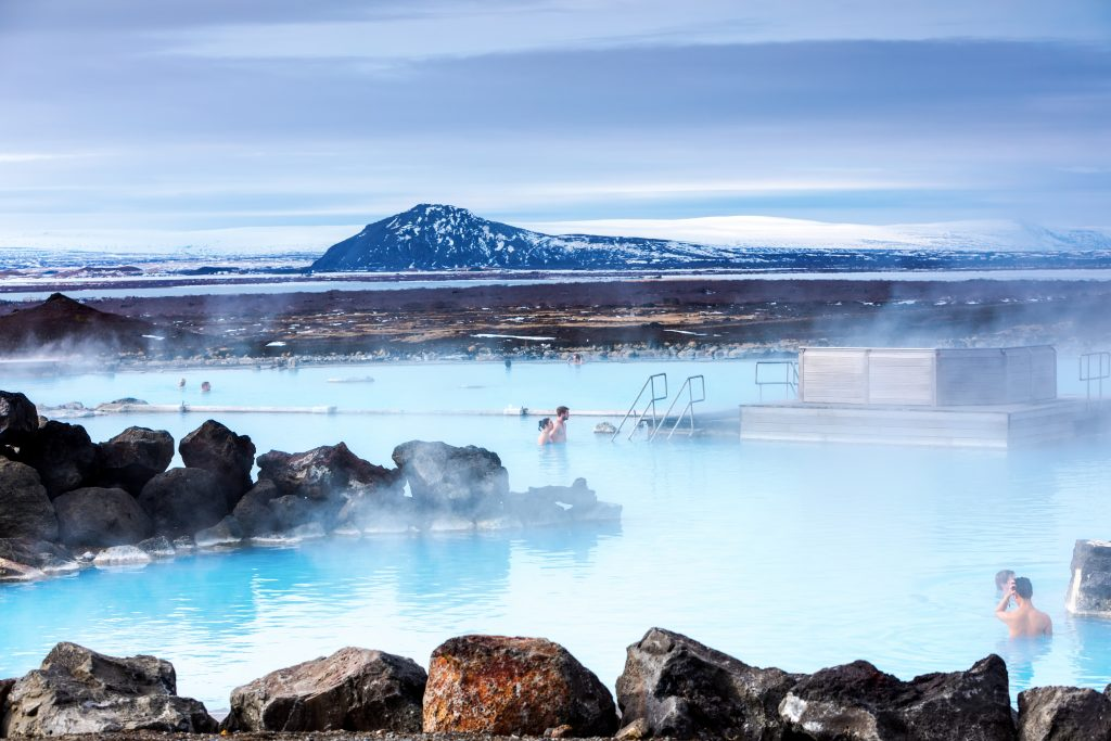 Bright blue water steams in cold Iceland air at Myvatn Nature Baths