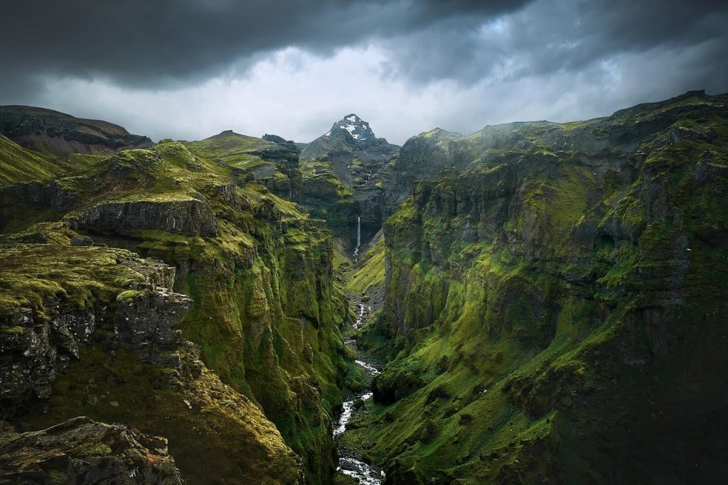 a view down a canyon covered with moss because not walking on the moss is one of the most important Iceland travel tips