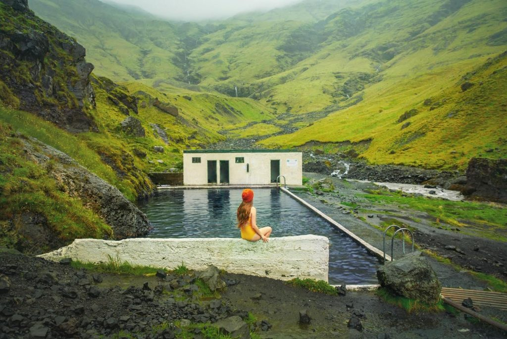 bringing your bathing suit is one of the most important Iceland travel tips so you can visit swimming pools like Seljavallalaug at the base of some mountains