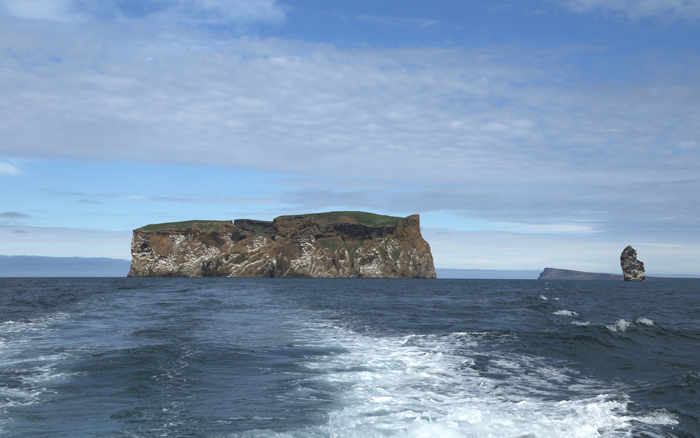 Drangey Island island in the Skagafjörður fjord in northern Iceland. It is the remnant of a 700,000‑year‑old volcano, and is a essentially a massive rock fortress!