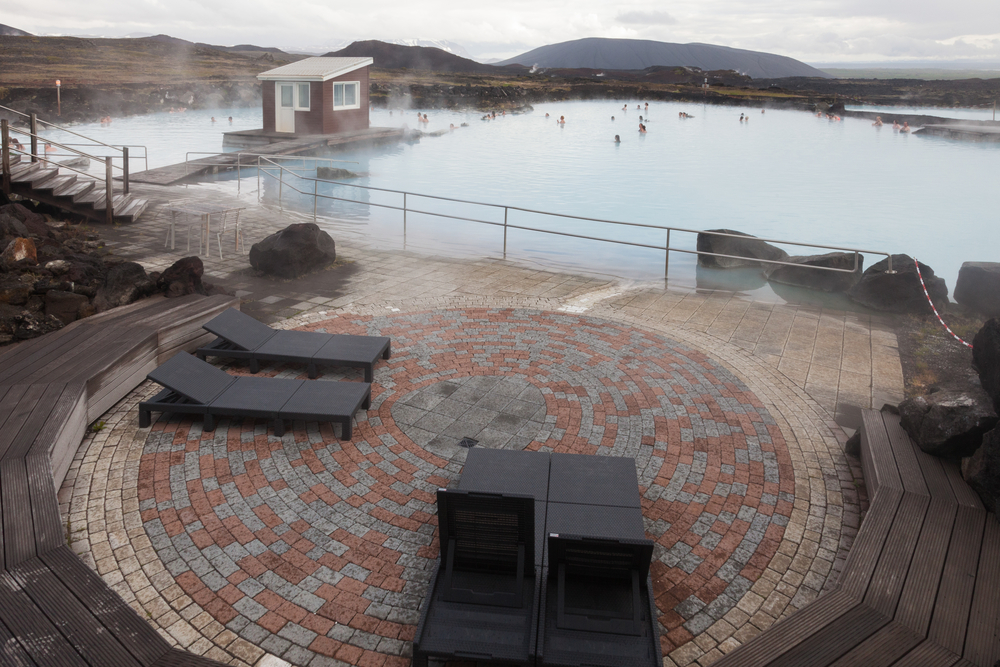Lounging area looks over hot springs in Iceland.