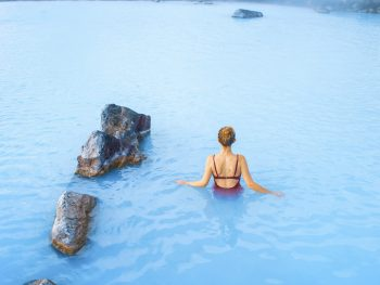 woman swimming in Myvatn Nature Baths in Iceland