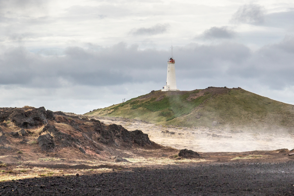 a view of the Reykjanesviti Lighthouse perched on the hill