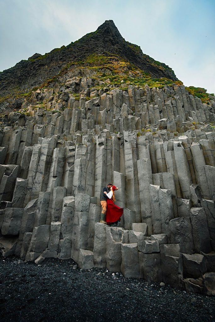 standing on the basalt columns at the Reynisfjara Black Sand Beach
