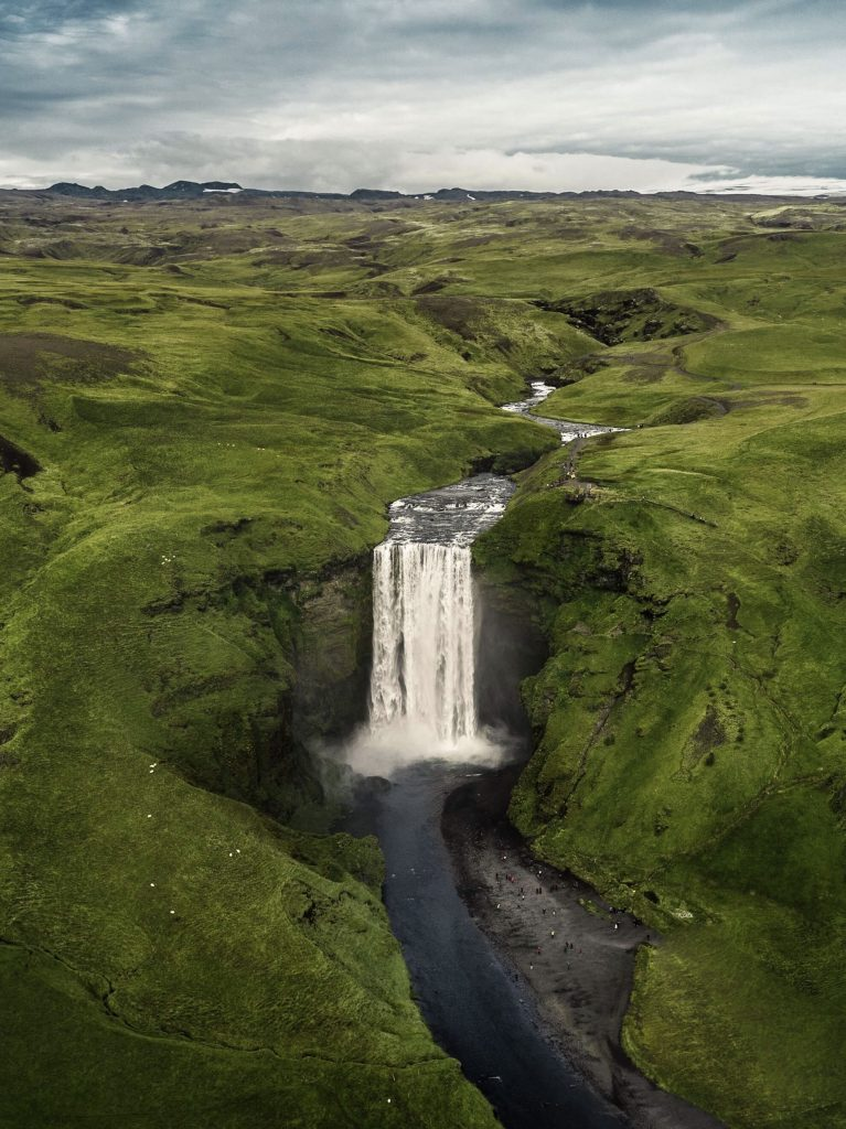 a view of Skogafoss and the surrounding landscape from above