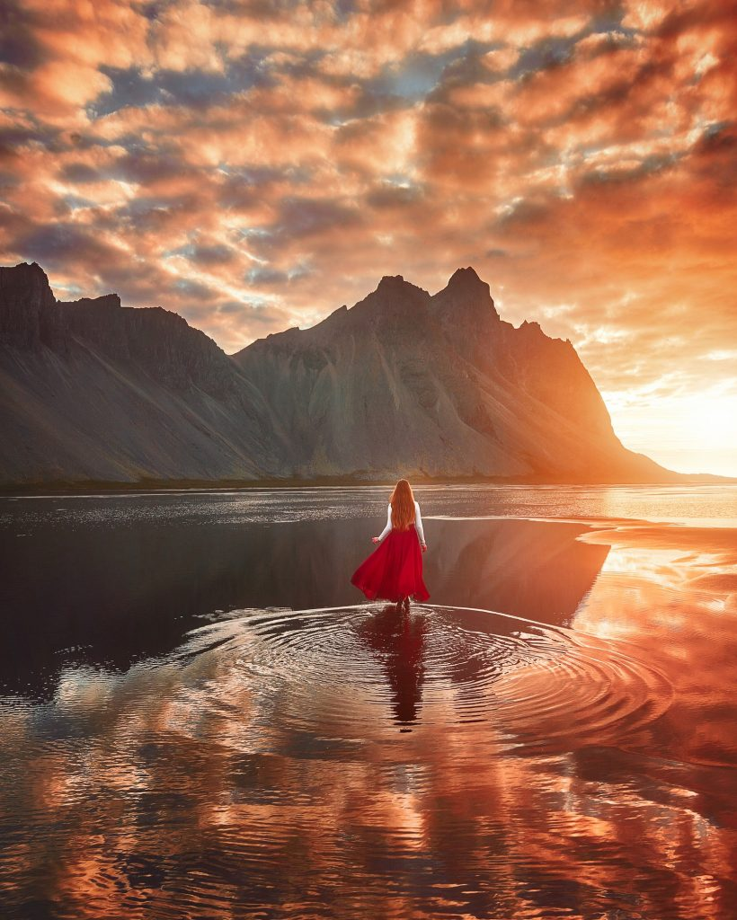 walking on the water at Stokksnes looking at the Vestrahorn mountains at sunrise