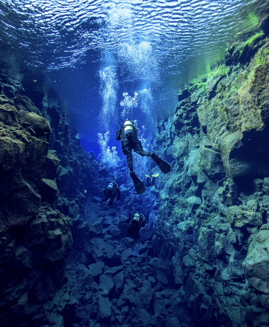 snorkeling the Silfra fissure at Thingvellir National Park during your 7 days in Iceland