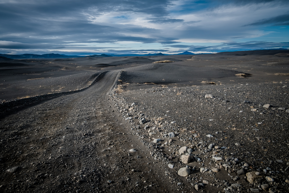 Rocky f-road in Iceland stretching into the distance.