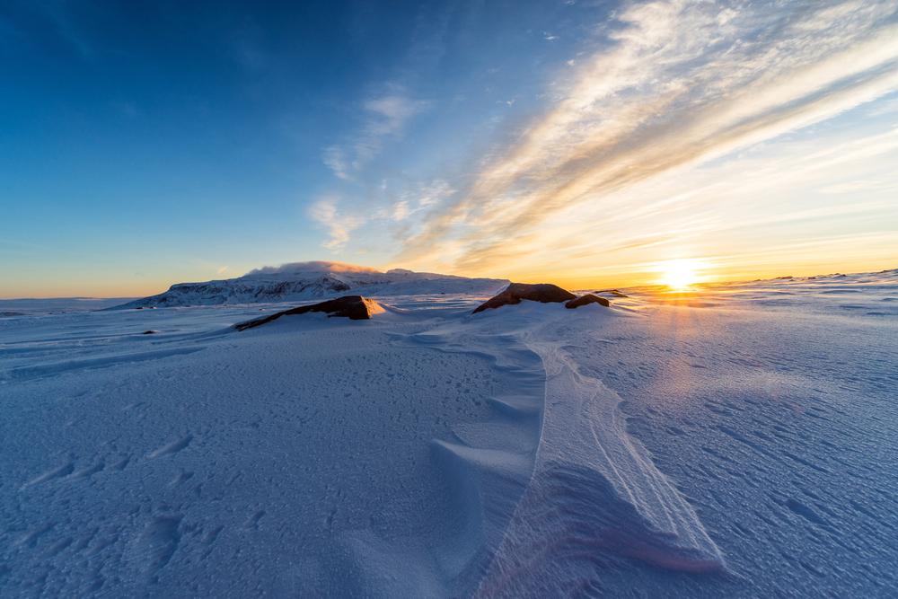 An expanse of snow at sunset at Langjokull Glacier.