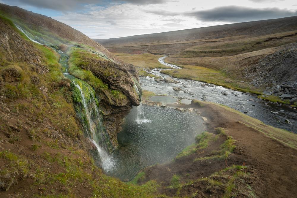 Waterfalls flowing into LaugavallalaugHot Springs.