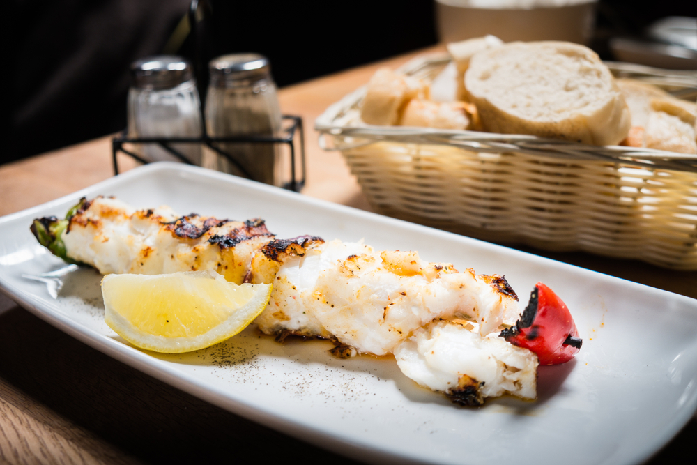 Grilled Fish on a plate in an article about restaurants in Iceland