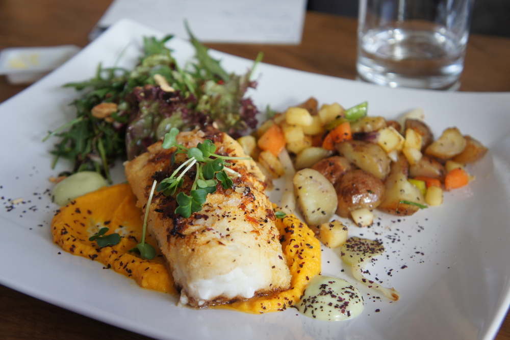 Cod steak on a plate with potatoes
