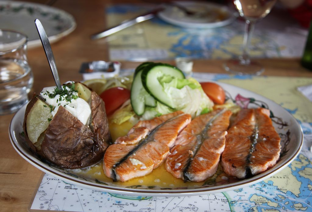 Smoked fish on a plate with potatoes